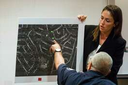 Prosecutor Jacqueline Valdes holds a map for San Antonio Police Officer Randy Lee Walter as he testifies in 2016 in a trial at the Bexar County 386th Juvenile District Court.