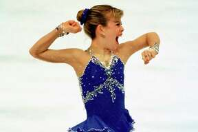 Tara Lipinski reacts as she finishes her long program.  Lipinski, of sugarland, won the gold medal in ladies figure skating at the 18th Winter Olympics Friday night Feb. 20, 1998 in Nagano, Japan.  Smiley N. Pool / Chronicle HOUCHRON CAPTION (02/21/1998): Upon completion of her long program Friday, Tara Lipinski knew her performance was as good as gold. 1998 WINTER OLYMPICS NAGANO, JAPAN