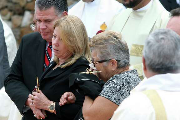 Maritza Fernandez, center, the mother of Miami pitcher Jose Fernandez, and grandmother Olga Fernandez, right, attend a memorial service.