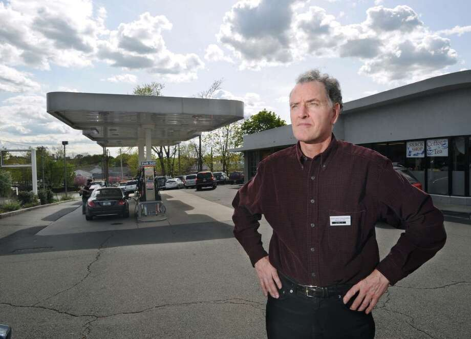 Chris Canavan, president of Greenwich Automotive Services, posed at his  service station on the corner of West Putnam Avenue and Dearfield Drive, Greenwich, Tuesday afternoon, April 20, 2010. Photo: Bob Luckey / Greenwich Time
