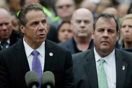 New York Gov. Andrew Cuomo, left, speaks during a news conference on the train crash at the Hoboken Terminal as New Jersey Gov. Chris Christie, right, listens, Thursday, Sept. 29, 2016, in Hoboken, N.J. A commuter train crashed into the rail station during the morning rush hour, causing serious damage and injuring dozens. (AP Photo/Julio Cortez) ORG XMIT: NJJC122
