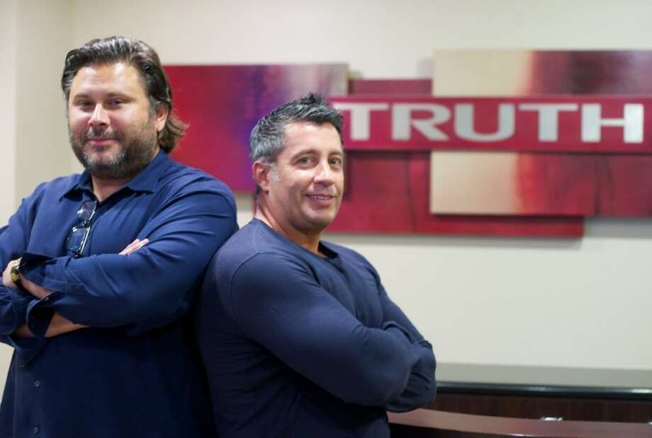"Joe Newcomb, left, and Tony Notargiacomo, founding partners in Truth Entertainment, are actively involved in principle photography for ""The Dallas Buyers Club,"" a feature film starring acting heavyweights Matthew McConaughey and Jennifer Garner. Photo: Staff Photo By Eric Swist"
