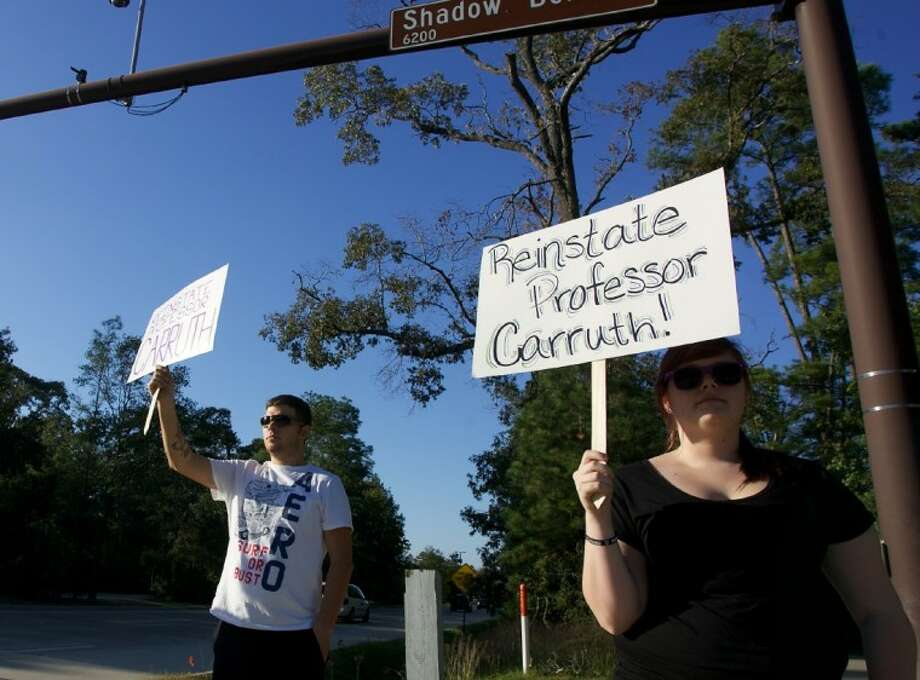 In this file photo taken Nov.1, John Velez, left, and Jessica Reddington hold signs as they protest outside the Lone Star College System's administrative offices in The Woodlands. A protest was held on the LSC- Montgomery campus Thursday. Photo: Staff Photo By Eric Swist