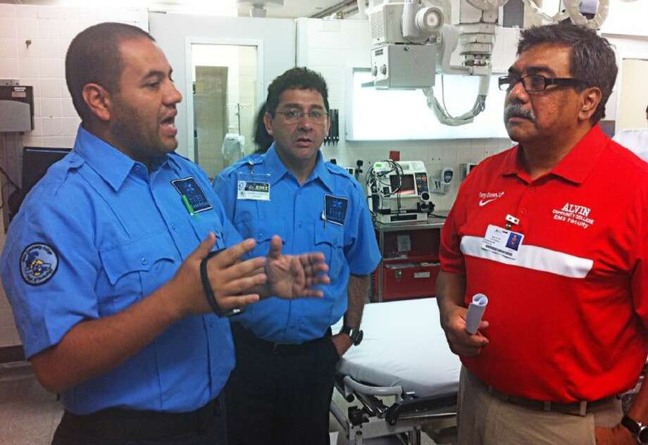 An ACC instructor works with Latin American students who are working towards a certification as an Emergency Medical Technician.