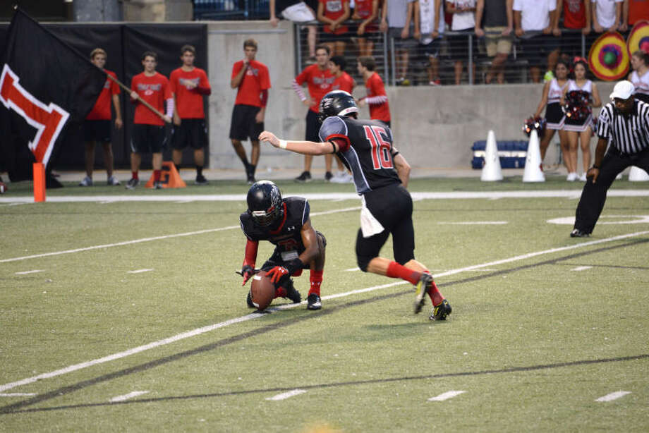 Langham Creek kicker Joel Scarbrough knocked in a 40-yard field goal as time expired to give the Lobos a 34-31 win over Klein Oak in 2013. Scarbrough is raising money for pediatric cancer research through the 2014 Joel Scarbrough Kicking Challenge. Photo: FILE PHOTO