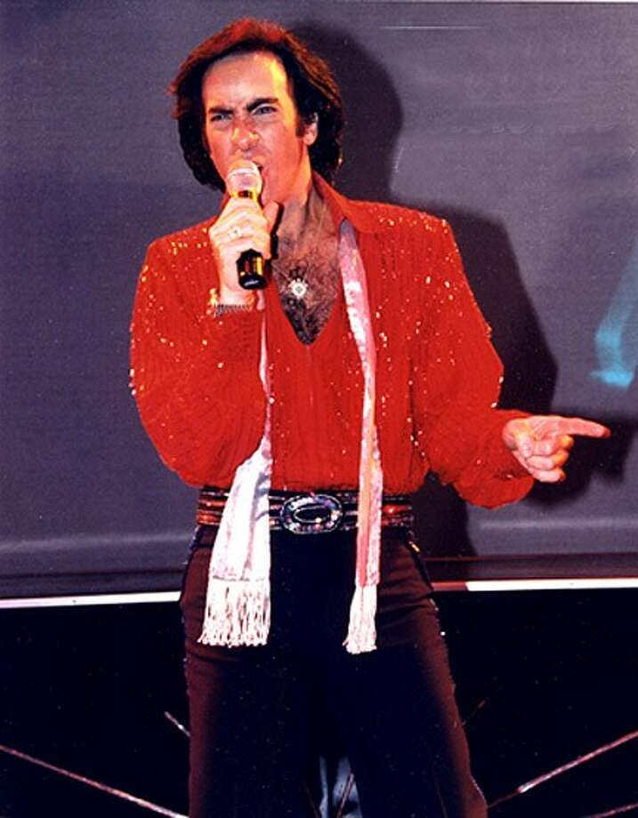 """Neil Diamond tribute artist Rob Garrett put on a show at the Crighton Theatre Saturday that was """"the next best thing"""" to spending a night with Neil himself according to People's Critic David Dow Bentley III."""