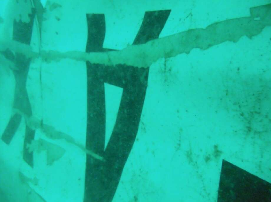 Indonesia's National Search and Rescue Agency released photos Wednesday of wreckage that it identified as of the ill-fated AirAsia Flight 8501 in the waters of the Java Sea. Photo: HOPD