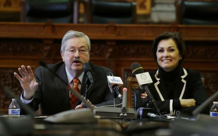 Iowa Gov. Terry Branstad speaks during The Associated Press' annual legislative seminar as Lt. Gov. Kim Reynolds, right, looks on, Wednesday at the Statehouse in Des Moines, Iowa.