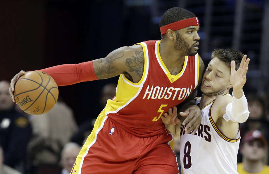 Houston Rockets' Josh Smith, left, drives past Cleveland Cavaliers' Matthew Dellavedova during an NBA basketball game Wednesday.