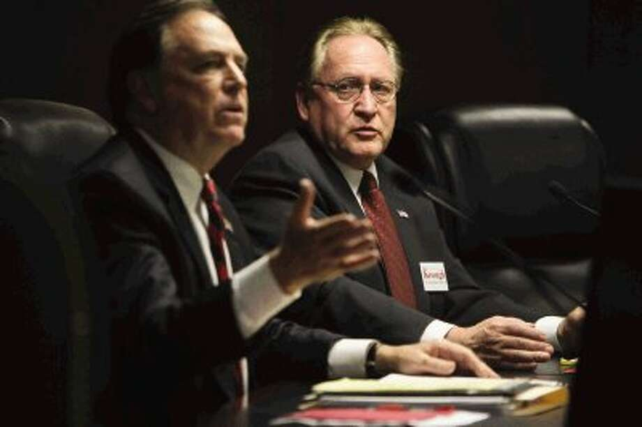 State Representative District 15 candidate Mark Keough, right, looks on as Bruce Tough gives his closing statement during a political forum at the Shenandoah City Council Chambers Thursday. Candidates for elected positions in District 15 and 16 attended the event to speak to voters concerning a variety of topics. Photo: Staff Photo By Jason Fochtman / Conroe Courier