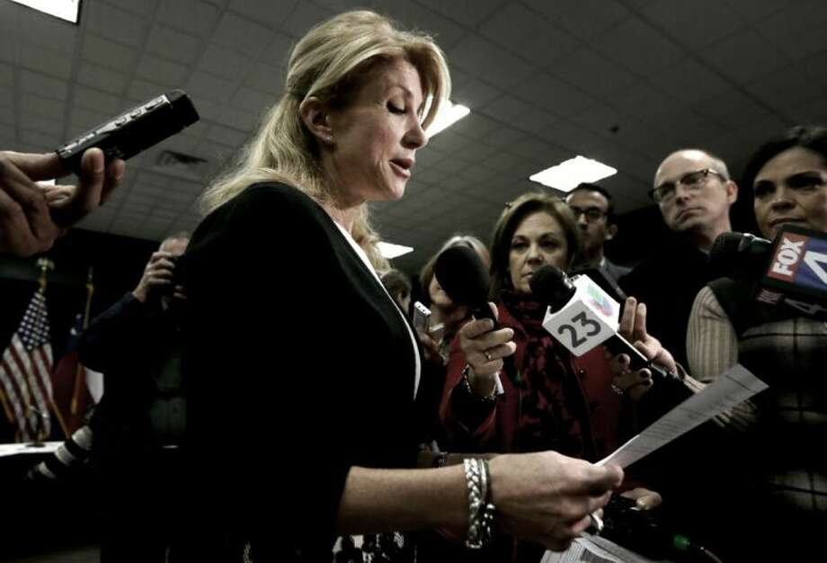 Texas Sen. Wendy Davis reads her education proposals to reporters after a meeting in Arlington Thursday. Davis, the presumptive Democratic nominee for Texas governor, unveiled education proposals at the North Texas roundtable meeting. Photo: LM Otero