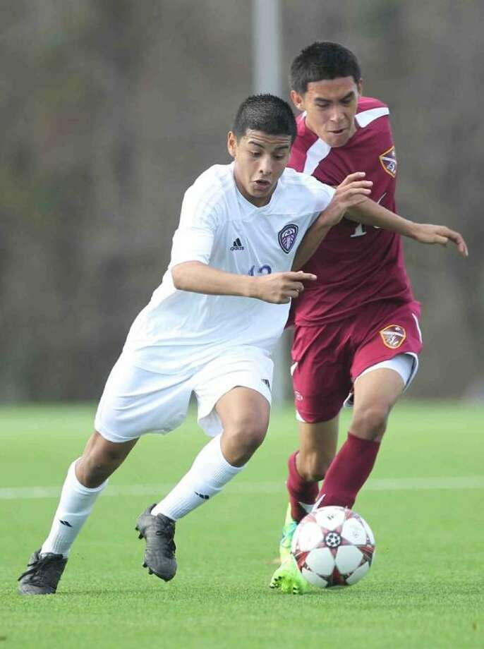 Willis' Antonio Perez fights for control of the ball during a match against Baytown Lee on Friday in the Kat Cup. Perez scored a goal and added three assists in the Wildkats' 5-2 victory. To view or purchase this photo and others like it, visit HCNpics.com. Photo: Staff Photo By Jason Fochtman