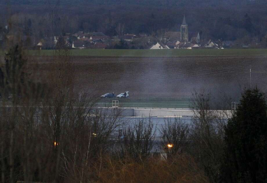 Smoke rises from a building in Dammartin-en-Goele, northeast of Paris, where the two brothers suspected in a deadly terror attack were cornered, Friday. Photo: Michel Spingler