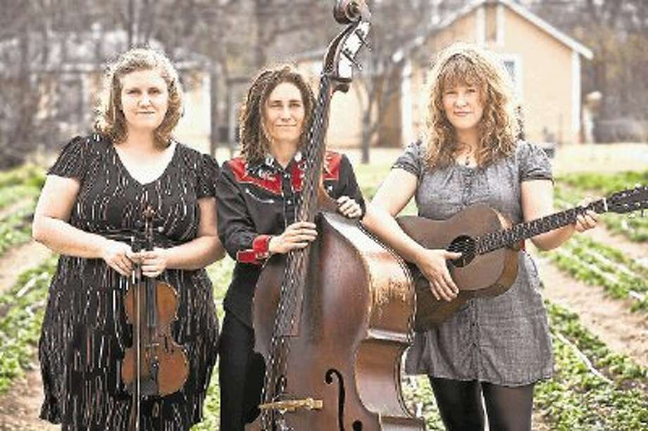 From left, Beth Chrisman on fiddle, Melissa Carper on upright bass and Jenn Miori on guitar. The trio makes up the Carper Family Band that will play on Saturday night and Sunday morning at The Red Brick Tavern in Conroe. / @WireImgId=2658042