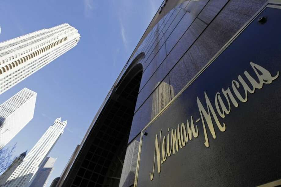 In this March 11, 2009 file photo, the Chicago skyline is reflected in the exterior of Neiman Marcus on Michigan Avenue in Chicago. Neiman Marcus confirmed Saturday that thieves may have stolen customers' credit and debit card information and made unauthorized charges over the holiday season, becoming the second retailer in recent weeks to announce it had fallen victim to a cyber-security attack.