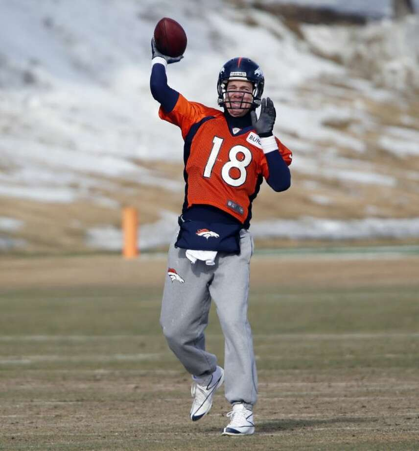 Denver quarterback Peyton Manning throws during practice for the Broncos' playoff game against the San Diego Chargers at the Broncos training facility on Friday in Englewood, Colo. Photo: Ed Andrieski