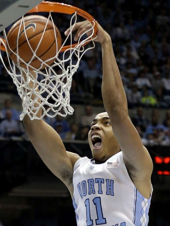North Carolina's Brice Johnson dunks during the first half of an NCAA college basketball game against Louisville in Chapel Hill on Saturday. Photo: Gerry Broome