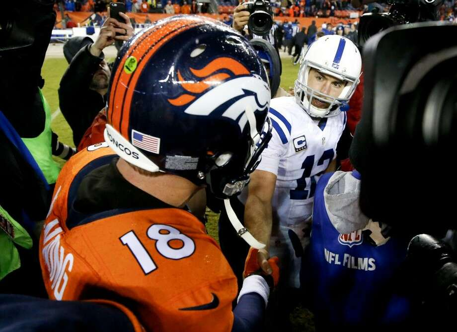 Broncos quarterback Peyton Manning, left, congratulates Colts quarterback Andrew Luck after the Colts' 24-13 victory. Photo: Jack Dempsey