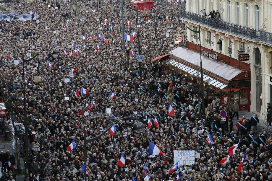 The crowd gather during a march in Paris, France Sunday. Hundreds of thousands of people marched through Paris on Sunday in a massive show of unity and defiance in the face of terrorism that killed 17 people in France's bleakest moment in half a century. Photo: Laurent Cipriani