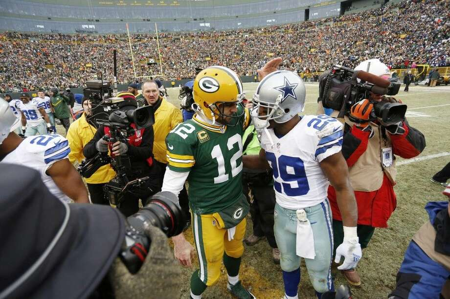 Cowboys running back DeMarco Murray, right, greets Packers quarterback Aaron Rodgers after Sunday's game. Murray became a free agent after Sunday's 26-21 loss to the Packers. Photo: Matt Ludtke