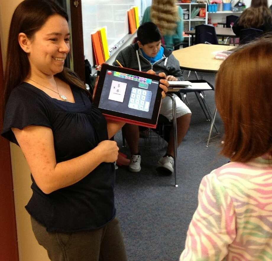 Back to school doesn't mean wait for class time to teach. Brabham Middle School's Barbara Payne is using her iPad to extend learning into the hallway. Students have to answer the math fact correctly before they enter the room. It's displayed on the iPad with the timer.