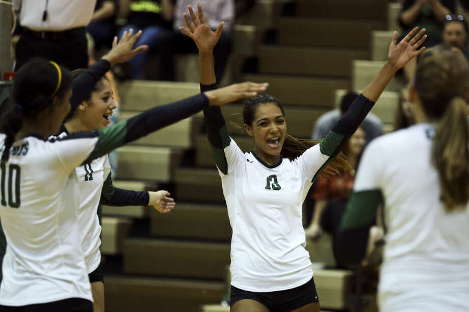 Cy Falls' Shae Chapman cheers with her teammates during the Golden Eagles' match against Langham Creek on Wednesday at Cy Falls High School. The Eagles swept the Lobos, 3-0. (Michael Minasi / HCN) Photo: Michael Minasi