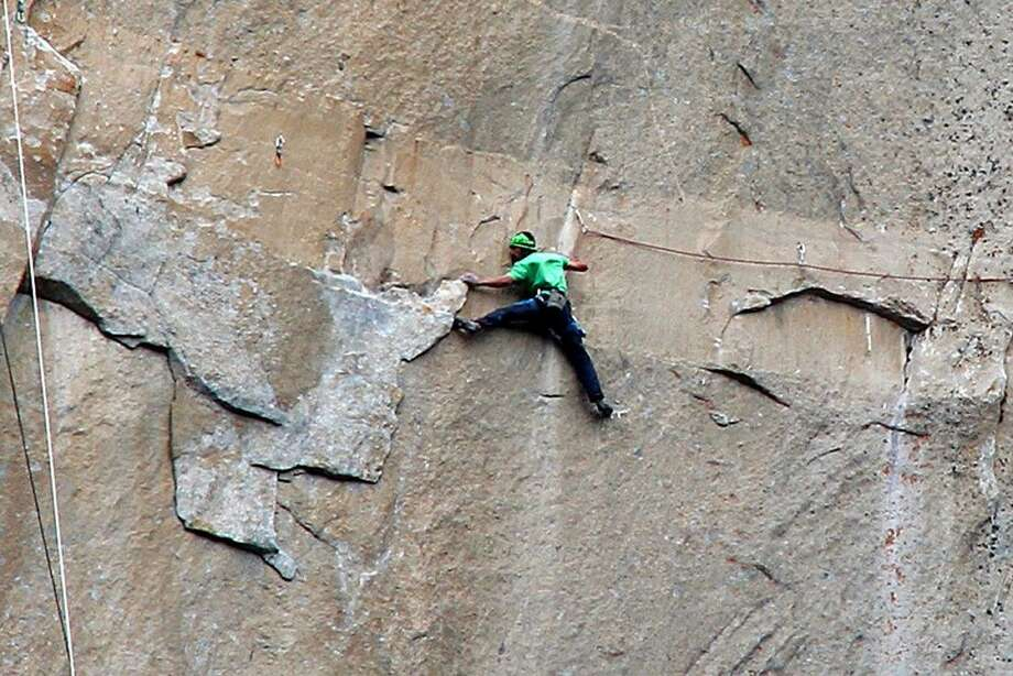 On Friday, Kevin Jorgeson climbs on what is known as pitch 15 during what has been called the hardest rock climb in the world: a free climb of El Capitan, the largest monolith of granite in the world, a half-mile section of exposed rock in California's Yosemite National Park. The first climber reached its summit in 1958, and there are roughly 100 routes up to the top. Photo: Tom Evans