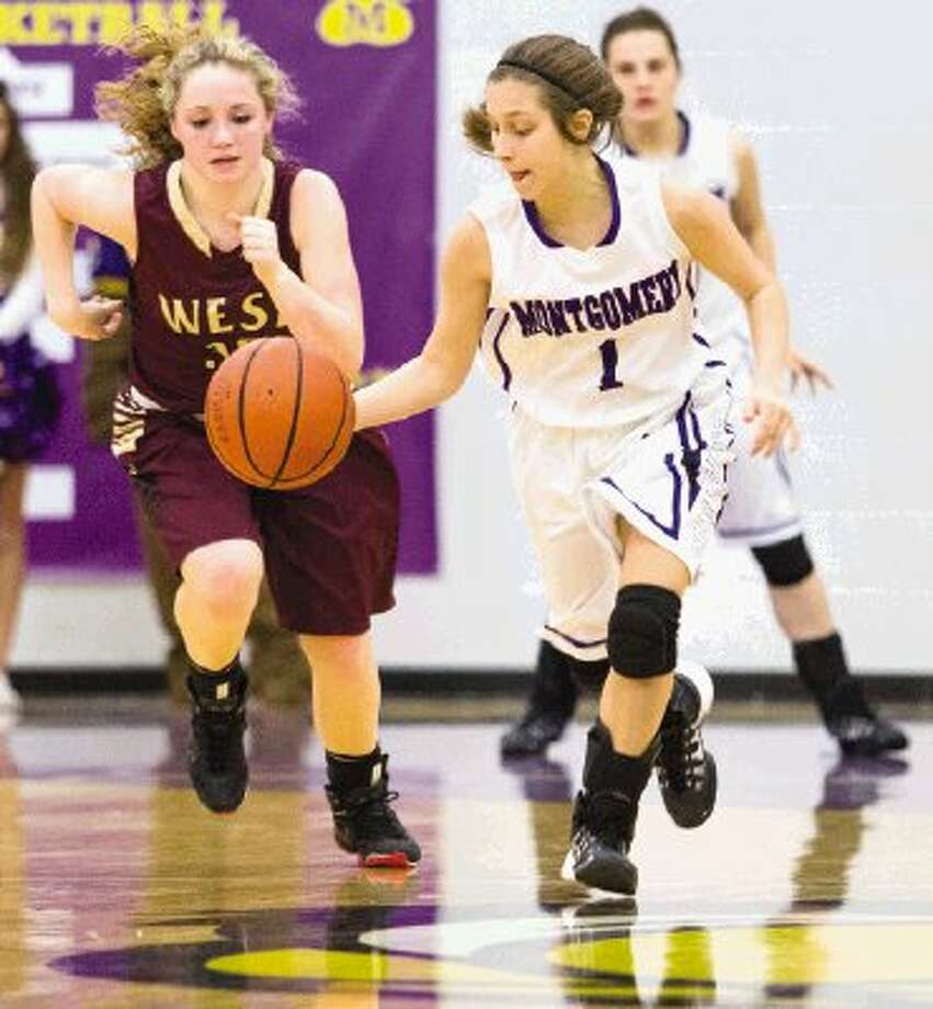 Magnolia West's Taylor Mitt chases Montgomery's Amber Szymczak during a District 18-4A game on Tuesday night at Montgomery High School. To view or purchase this photo and others like it, visit HCNpics.com. Photo: Staff Photo By Ana Ramirez / The Conroe Courier/ The Woodland