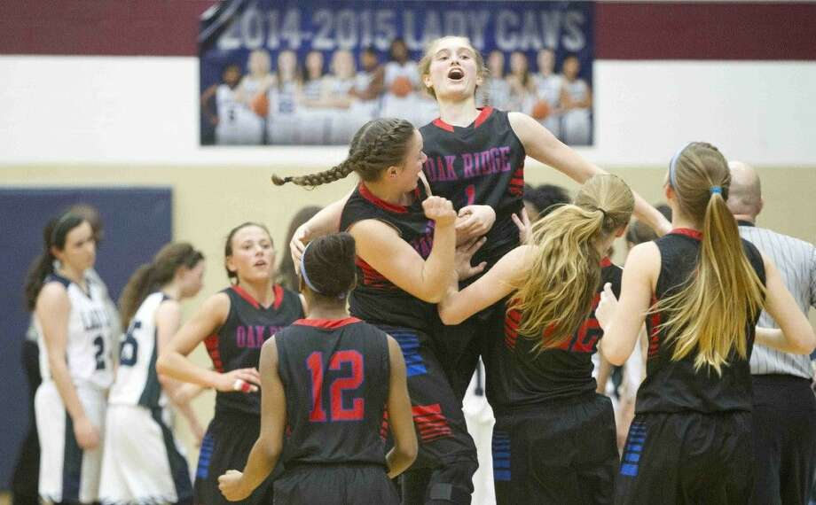 Oak Ridge's Kameron Boren celebrates the Lady War Eagles' 52-40 overtime win over College Park. To view or purchase this photo and others like it, visit HCNpics.com. Photo: Jason Fochtman