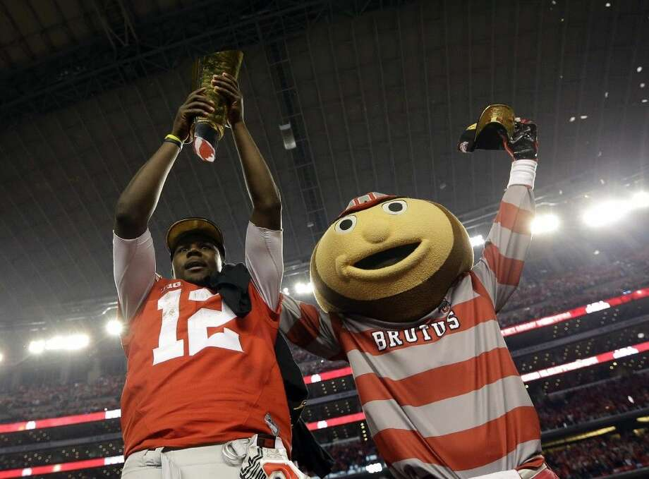 Ohio State's Cardale Jones and the school's mascot celebrate after the Buckeyes' 42-20 victory over Oregon. Photo: David J. Phillip