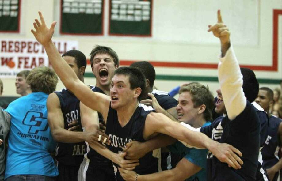 College Park forward Jayden Holden celebrates with fans and teammates after hitting a buzzer-beating 3-pointer to give the Cavaliers a 45-43 win over The Woodlands on Tuesday night at The Woodlands High School. To view or purchase this photo and others like it, visit HCNpics.com. Photo: Staff Photo By Jason Fochtman