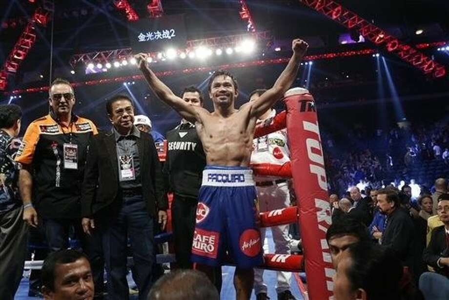 Boxer Manny Pacquiao has agreed to terms for a fight against Floyd Mayweather, according to promoter Bob Arum. Photo: Kin Cheung