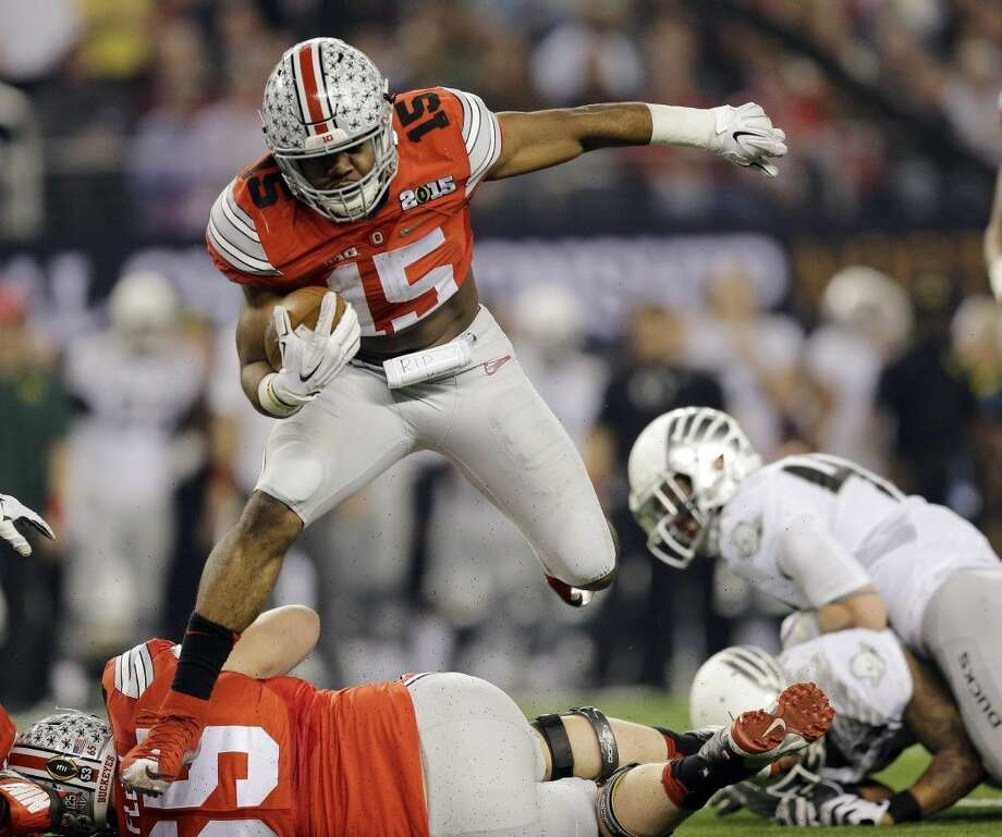 Ohio State's Ezekiel Elliott finished third in the nation in rushing after strong performances during the College Football Playoff. Photo: Eric Gay