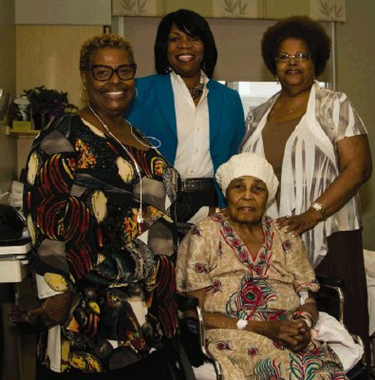 Former teacher Lucille Bradley takes a photo with Grecian Holly, Letha Moore and Linda Cullins during her 100th birthday in November at the Reliant Rehabilitation Center in Shenandoah. Bradley died Sunday while recuperating from hip surgery.
