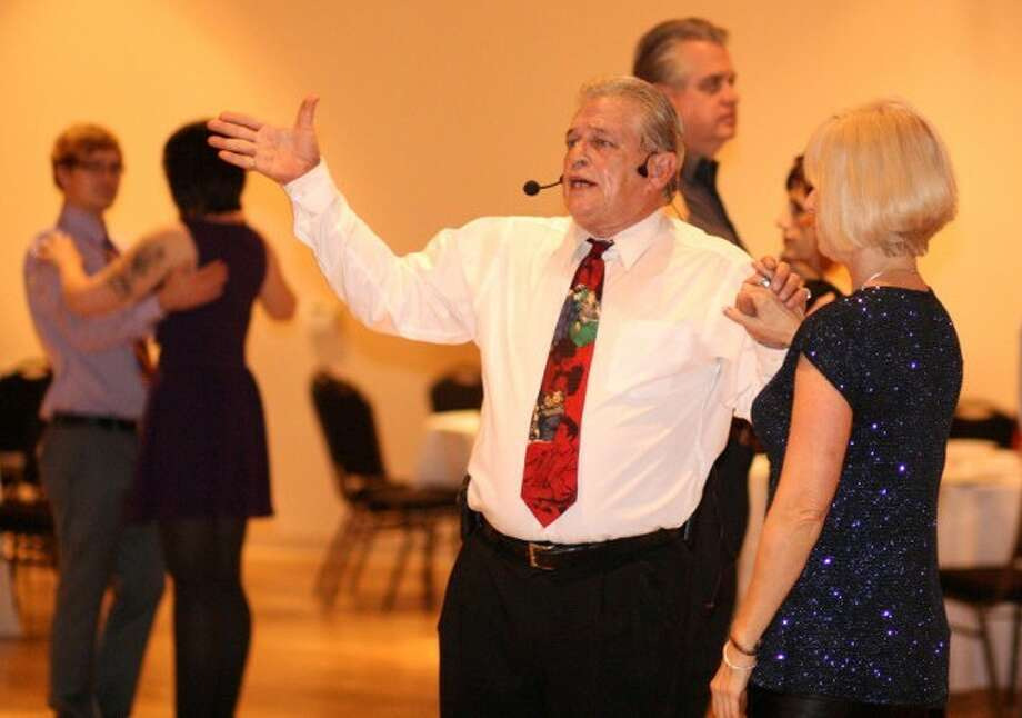 Steps in Faith Ministry Founder Gene Cook, of Willis, teaches others how to ballroom dance. Cook believes teaching it is a gift from God and started a ministry to serve others with it.