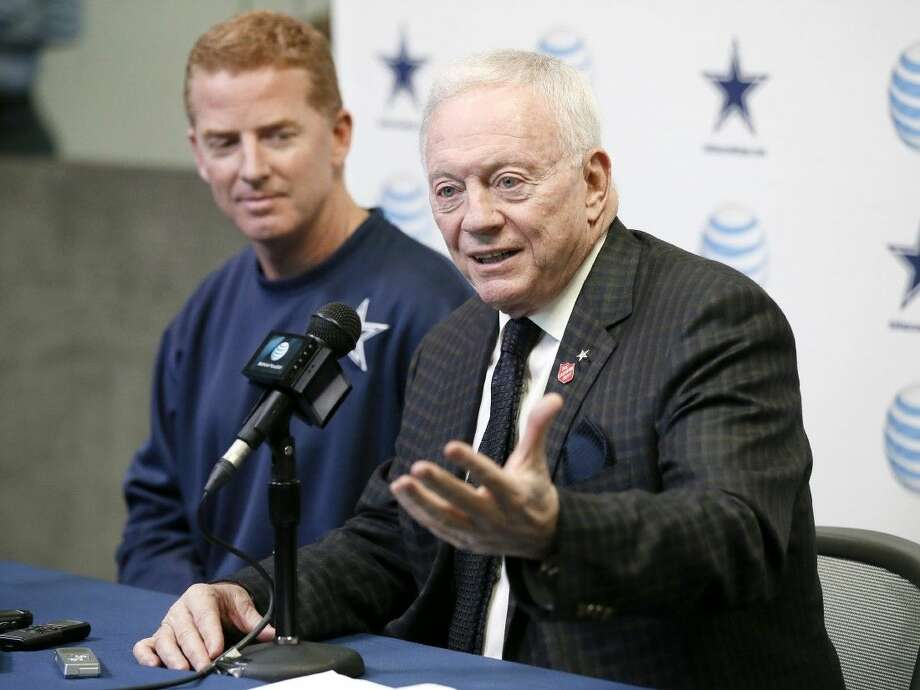 Dallas Cowboys team owner Jerry Jones, front, responds to questions about coach Jason Garrett's five-year contract extension. Photo: Tony Gutierrez