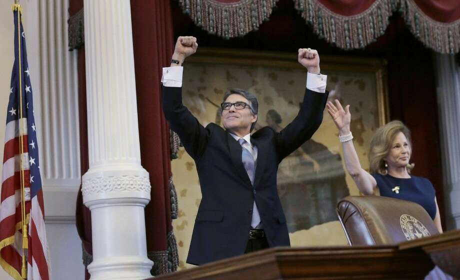 Texas Gov. Rick Perry, left, acknowledges applause next to his wife, Anita, before giving a farewell speech to a joint session of the Texas Legislature on Thursday in Austin. Photo: Eric Gay