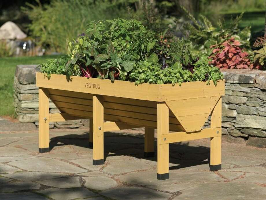 Elevated gardens allow gardeners to easily plant herbs, vegetables and flowers anywhere. Photo courtesy of Gardener's Supply.