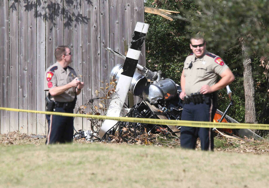 MCSO deputies stand at the scene of a fatal helicopter crash near The Woodlands area at the 2500 block of Northline Road on Friday.