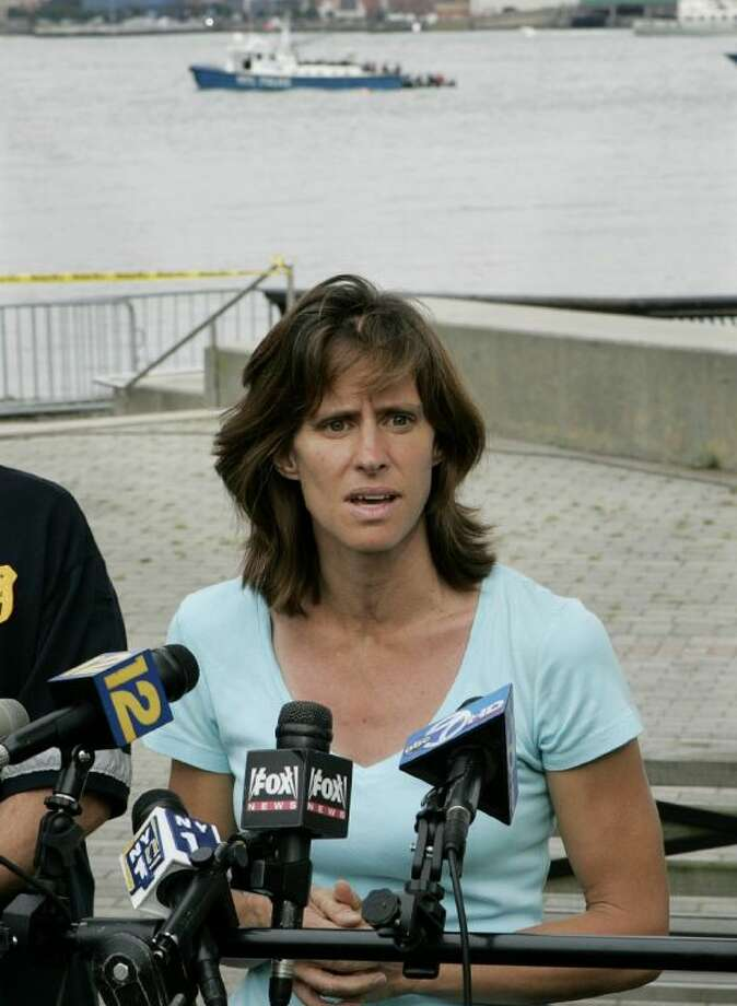 In this Aug. 8, 2009 file photograph, Hoboken Mayor, Dawn Zimmer speaks to the media as she stands near the Hudson River in Hoboken, N.J. Zimmer, mayor of a New Jersey city that sustained severe flooding from Hurricane Sandy claims the Christie administration withheld millions of dollars in recovery grants because she refused to sign off on a politically connected development. MSNBC first reported her comments Saturday.