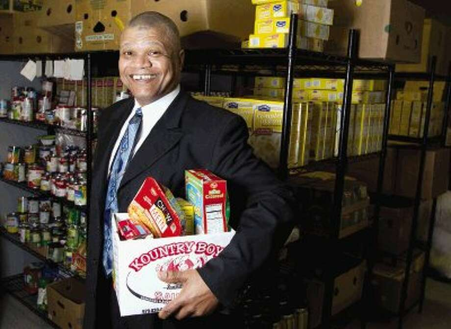 Michael Hayles, CEO of Coat of Many Colors Ministries, poses for a portrait in the organization's food pantry in Montgomery on Thursday. In addition to offering food for community members in need, the organization offers a variety of free employment training programs. Photo: Staff Photo By Jason Fochtman / Conroe Courier / HCN