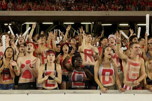 University of Houston fans celebrate for the team during the first half of the game against University of Connecticut at TDECU Stadium Thursday, Sept. 29, 2016, in Houston.