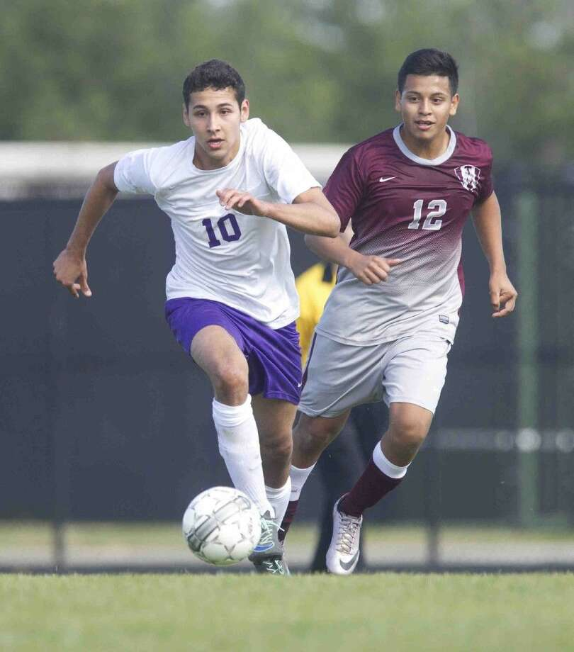 Montgomery's Abraham Shaheen, left, goes after the ball as Magnolia's Rolando Mejia gives chase. Montgomery played to a 0-0 draw against Magnolia. To view or purchase this photo and others like it, visit HCNpics.com. Photo: Jason Fochtman