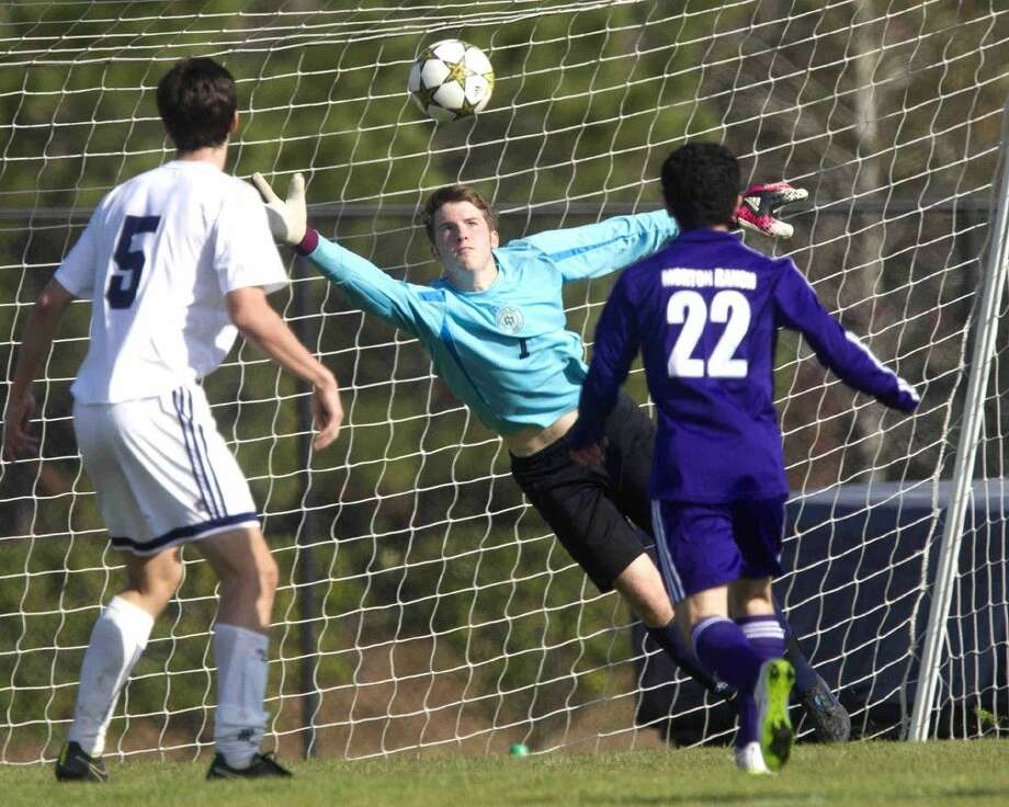 College Park goalkeeper Mike Wick makes a diving save during a high school soccer game against Morton Ranch on Saturday. College Park defeated Morton Ranch 2-1. To view or purchase this photo and others like it, visit HCNpics.com. Photo: Jason Fochtman