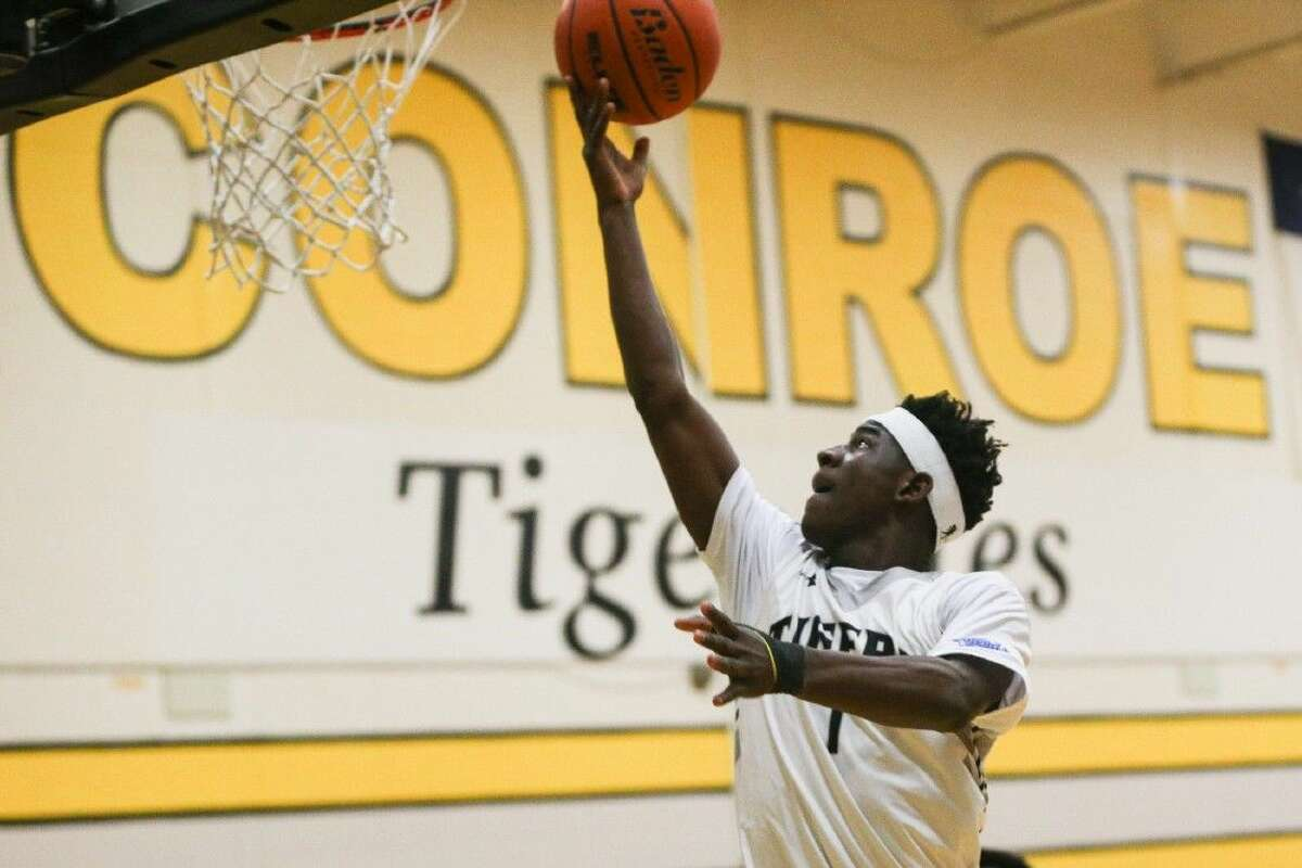 Conroe's Jay Lewis (1) goes for a layup during this past Tuesday against Katy.