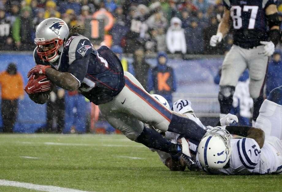New England Patriots running back LeGarrette Blount (29) scores on a 13-yard touchdown run. The Patriots beat the Colts 45-7. Photo: Matt Slocum