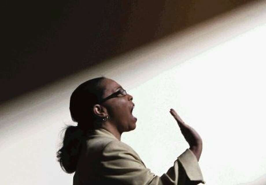 "Sandie Pullen sings during the ""Living the Dream"" program in celebration of the life of Dr. Martin Luther King, Jr. at The Woodlands Methodist Church Monday. Hundreds of worshipers came to pay tribute to celebrate King's contribution to the civil rights movement. To view or purchase this photo and others like it, visit HCNpics.com. Photo: Staff Photo By Jason Fochtman / Conroe Courier"