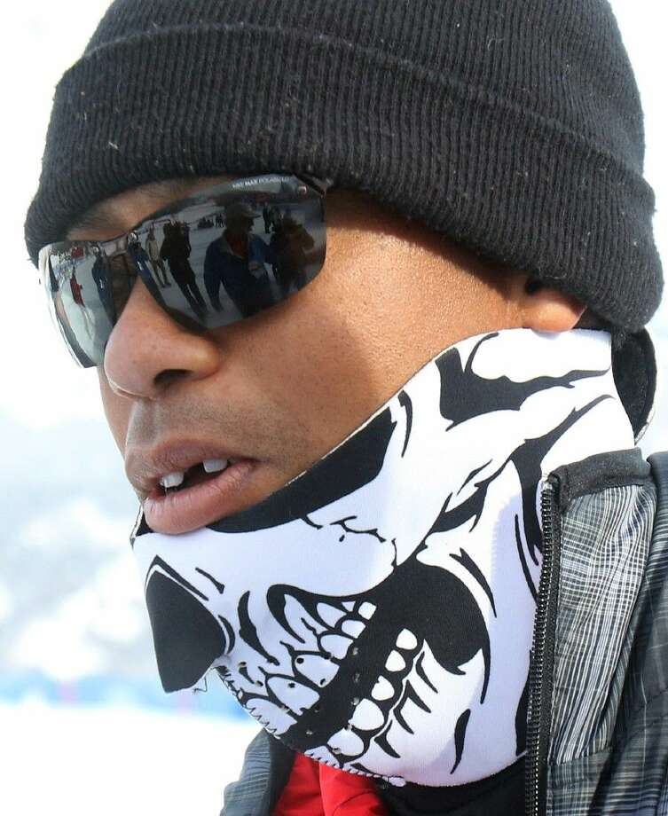 Tiger Woods walks in the finish area of an alpine ski, women's World Cup super-G, in Cortina d'Ampezzo, Italy Monday. Photo: Armando