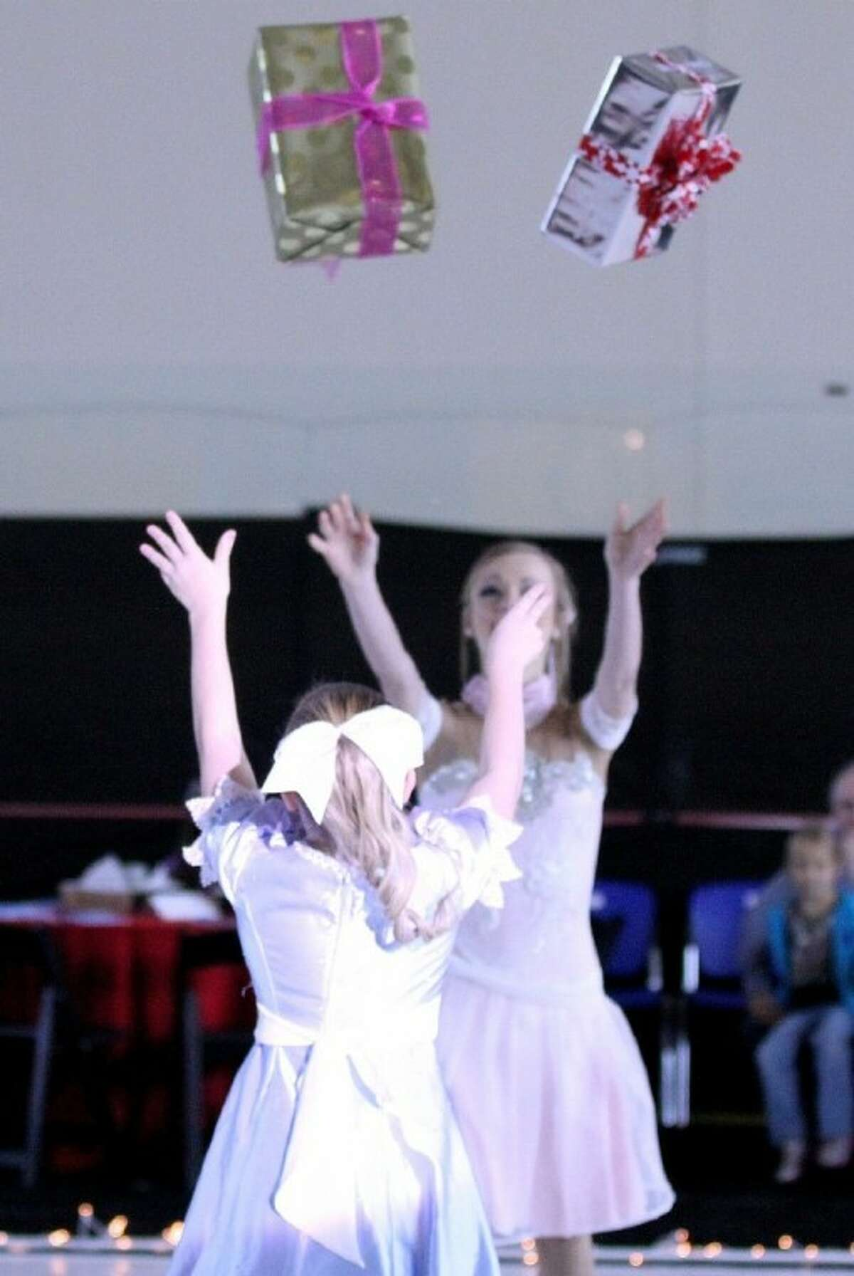 Tossing gifts in the air during the Nutcracker on Ice.