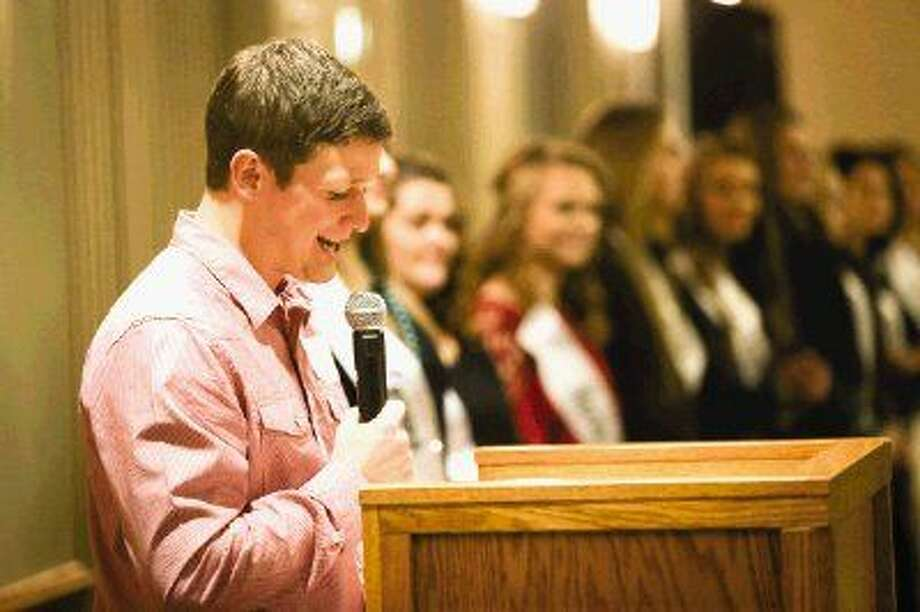 Youth pastor Derrick Drake, of Lone Star Cowboy Church, introduces the 2015 Fair Queen nominees during the Fair Queen Media Party on Monday at the Lone Star Convention Center. Photo: Michael Minasi